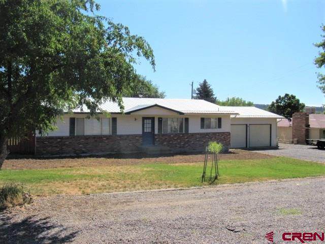 Must See!  This 3 bed 2 bath home has excellent location just north of Beautiful Cedaredge Colorado with easy and quick access to the Grand Mesa National Forest where unlimited fun awaits!  Large .31 acre lot with attached 2 car garage and fenced back yard.  Two storage sheds and covered patio! Large front yard with room for RV'S and toy haulers.  Inside has 2 updated bathrooms with beautiful tile showers and flooring. Large open living area!  Pretty white brick fireplace in the living for cozy winter days.