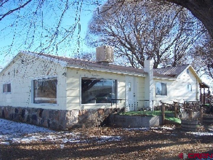Wonderful location. This 3-bedroom, one bath home is located at the corner of Highway 65 and Fairview Road in Cory, Colorado. The property could be used as commercial with approx. 300 ft of Hwy 65 frontage.  Natural gas to home. Detached garage with workroom, half bath, heated, electrical and water.  Home could use some love, but at this price don't wait it will not last long.  Easy commute to Delta, Grand Junction, Cedaredge or Montrose.
