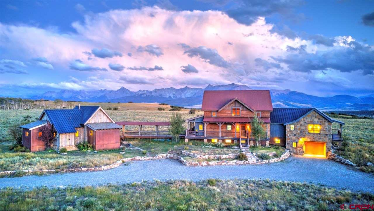 This is not your average ranch property! A truly unique offering, three separate structures and 164 acres make up the ''Not Yet'' Ranch in the gated San Juan Ranch development. A beautiful 45 minute drive from Telluride takes you to this gorgeous knoll top estate with views in every direction. The property is comprised of a fabulous main home made of mostly recycled materials attached by a covered walk way to the 3 bedroom / 3 bathroom guest house surrounded by 360 degree views of all the major mountain ranges in the area. A detached garage/barn with a one bedroom guest house or caretakers unit rounds out this gorgeous property. Wildlife is abundant in the front yard. A must see for those wanting land, views, and privacy- with a sub $3 million price tag, this won't last long!