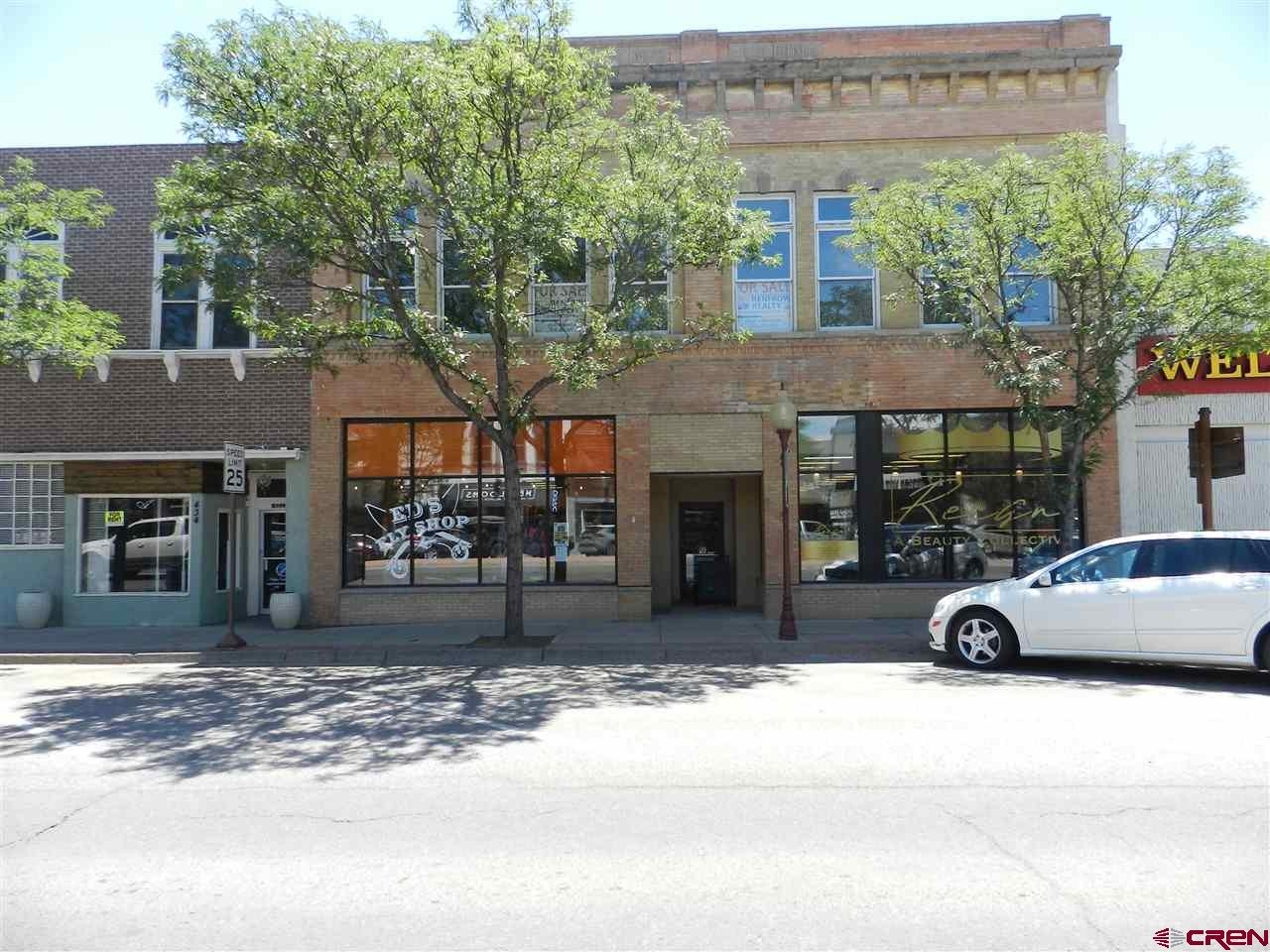 11,708 sq.ft. (MOL) which includes, two 2,200 sq.ft. (MOL) historic downtown retail spaces and 5,880 sq.ft. (MOL) upper story office/apartment potential. Two street-level retail units with back common area of two ADA restrooms, storage and double delivery door from alley. 432 E Main is currently leased, 428 E Main will be available the end of September. Second story has beautiful hardwood staircase from Main Street and newly constructed rear staircase to alley. Open canvas to build-out expansive upper space to professional offices, apartments, live-work studios or a combination. Adjacent to Wells Fargo Bank and central to downtown's restaurants and shopping. Assessor does not currently recognize second story in its heated square footage.  Incredible tax break with Opportunity Zone designation!