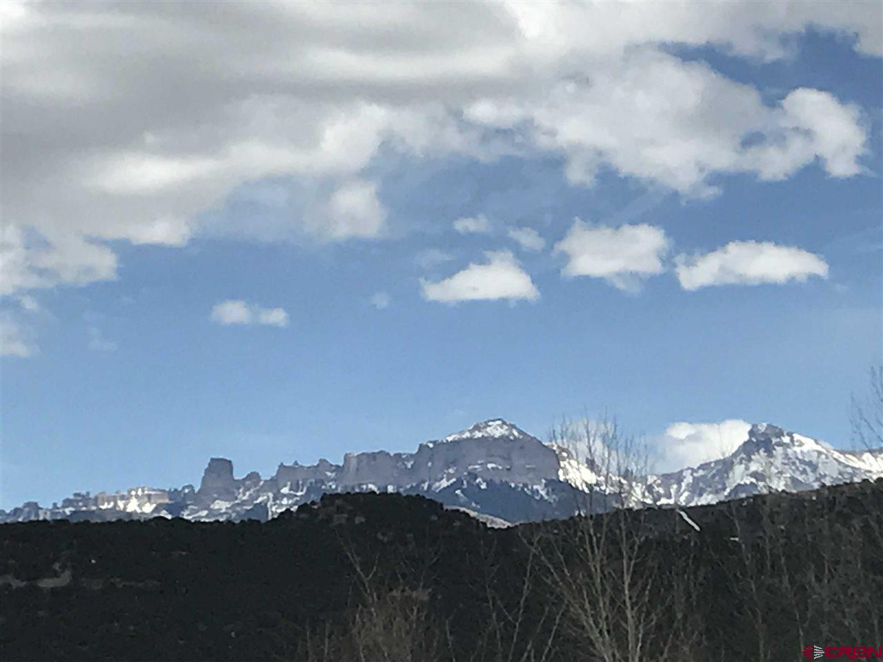 25,483 square feet of commecial land located in downtown Ridgway near the river.  This property is prime for development in bustling Ridgway.  Great location South of Liddell allows tons of potential from cannabis distribution to residential development or multi-use.  All utilities are adjacent to the property. great river and mountain views.