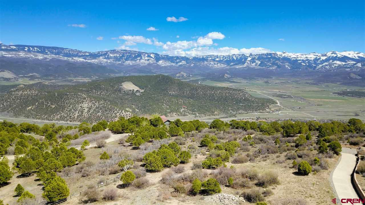 "Can you say views forever?  .5 acre lot in the exclusive subdivision of The Retreat on Log Hill.  One of the largest lots in the subdivision with amazing views and a great building site.  If peace, quiet and tranquility are what you're looking for the don't miss this incredible opportunity!!  Excellent opportunity to come and build your dream home or whatever you might want.  Enjoy being out in the ""country"" while you are just minutes from all the amenities of town.  And literally less than 5 minutes to a world class golf course.  Don't forget the wildlife and nature all around is included at no additional cost!!  All underground utilities, sewer tap is included in purchase price. Take a look at this one today."