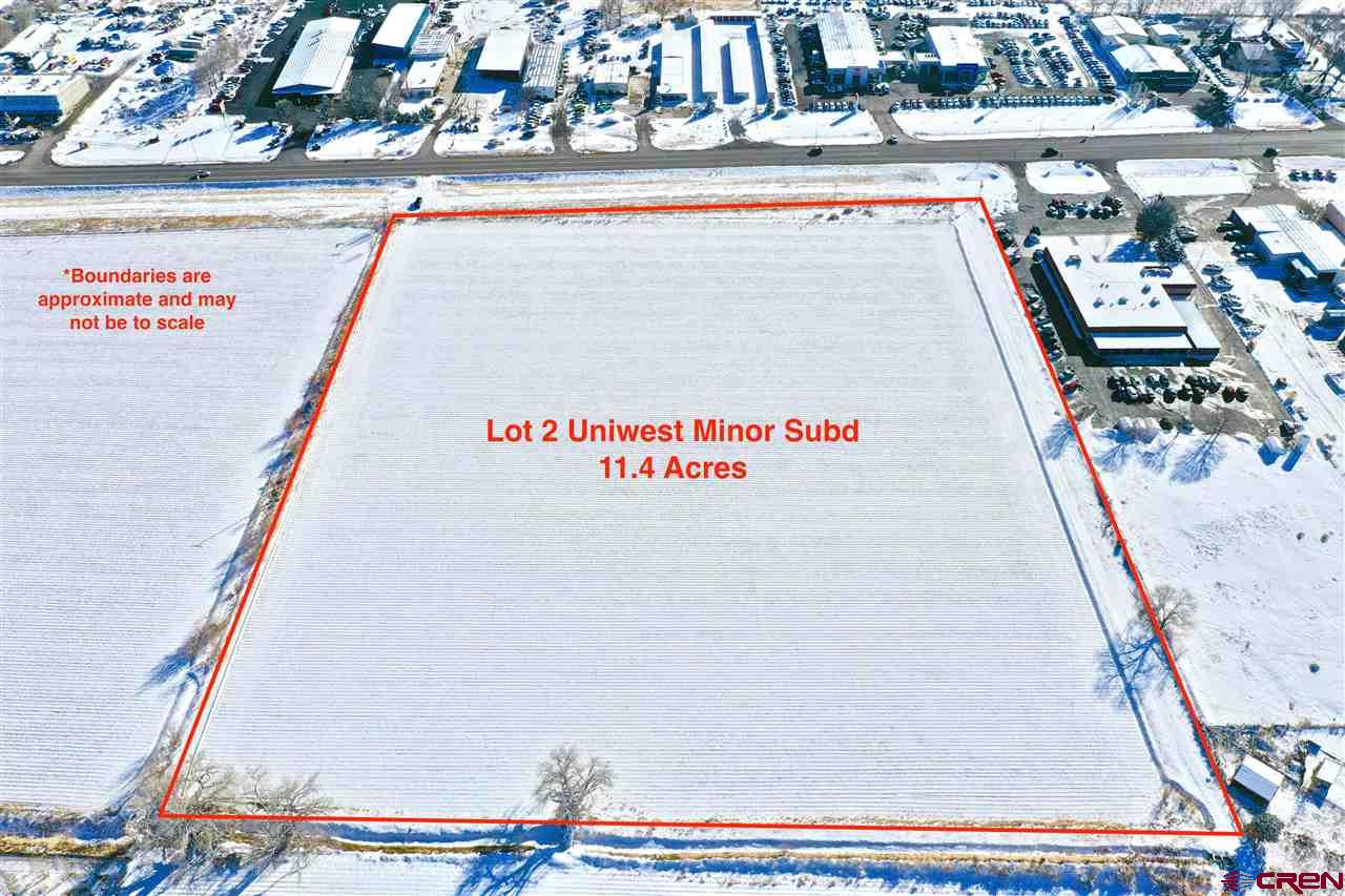 Level and ready to develop 11.4 acre parcel with access to all utilities and water rights (11.4 Shares UVWUA water) priced at less than $0.91 per foot. Also has 661 Ft. of CO Hwy 50 frontage along entire souther edge. Lot is currently in the Qualified Opportunity Zone and the Colorado Enterprise Zone both with tax advantages for the right buyer. Currently Zoned B-3 (General Commercial District) for many possible uses. There is also a 10.53 acre lot contiguous to the to the East available. This parcel is perfectly located on the eastern edge of Montrose with excellent HWY traffic for visibility and access and great frontage for potential development. Neighbors include Truck stop, Natural Gas Company Shop/Offices, Rec Vehicle Dealership, Large Car Dealership, Storage Units, Hotels, and Some Small commercial companies. The lot is also only minutes drive to the Black Canyon National Park, and a little farther to the Blue Mesa Reservoir & Curecanti National Recreation Area. With the great proximity to all this as well the world class fishing, site seeing, and outdoor recreation that comes with it.