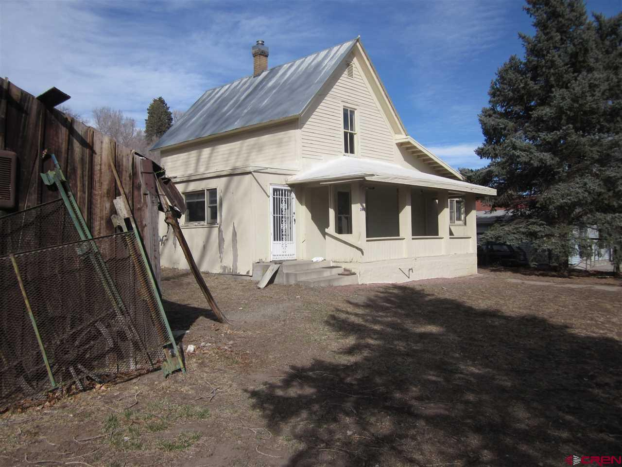 Preliminary work is started on this great project. Remodel this historic home in downtown Hotchkiss on the fantastic sunny side of the street. Two deeded parcels of land, with two addresses, with deeded ROW. Located next to the existing Town Hall. 2-blocks from restaurants, library, medical offices.  Initial work has already begun: new 2020 survey with boundary adjustments, added land to parcels, topo-elevation map, pre-remodel testing and Permit Ready Architectural Plans are available. New 220 volt electric to Property, 2-meters, new gas line, and new water line. Remodel to a 2, 500 square foot, 4-bedroom, 2.5 baths. This easily would be the finest house in old town Hotchkiss after renovation. Builders get ready to partner up on this one. Motivated seller.