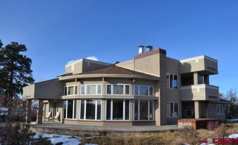 This lovely mountain villa was designed by premiere architect Patrick Davis and features sweeping curvatures throughout, significant views of the 14,000' Wilson Range, extravagant finishes, a gourmet kitchen, custom milled-clear oak cabinetry and trim, quartzite stone floors with in-floor radiant heat, and two master suites. Being an exceptionally comfortable Iron Springs Mesa home , it sits on 36 acres of meadow and Ponderosa Pines, that providing tremendous privacy. A great well, Road Association snow removal, and RF internet from Brain Storm, make mesa living seamless. The county road is paved, and the neighborhood has a bevy of new families enjoying the country life!