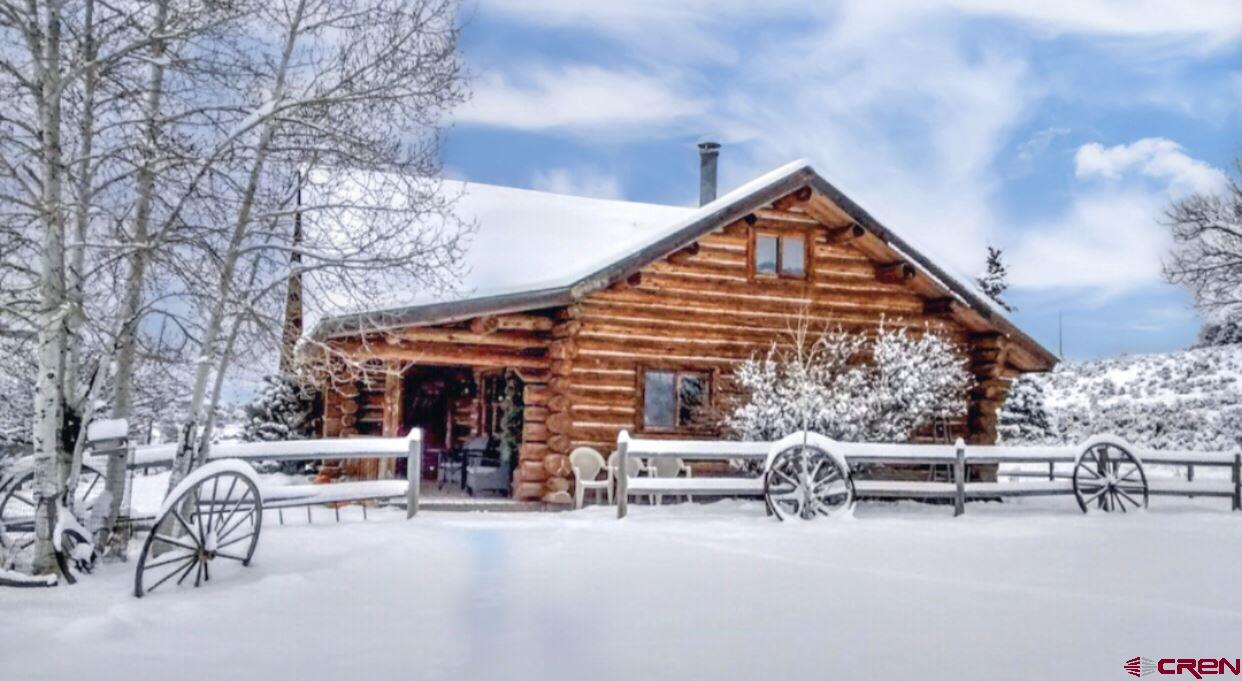 An incredible opportunity to own an exquisite horse property with TWO homes.  This property features a very lucrative AirBNB Log cabin, featured on the Travel Channel as one of the best Vacation Rentals in the U.S.!  It has a beautifully designed 100 x 250 Olympic size riding arena and a 2 story barn to host events and pamper your horses..  This turn key, fully furnished Estate sits on 15+ acres with breathtaking views of The Cimarron's and The San Juan Mountain Range.  Located just minutes from the Heart of Ridgway.  Endless possibilities await!