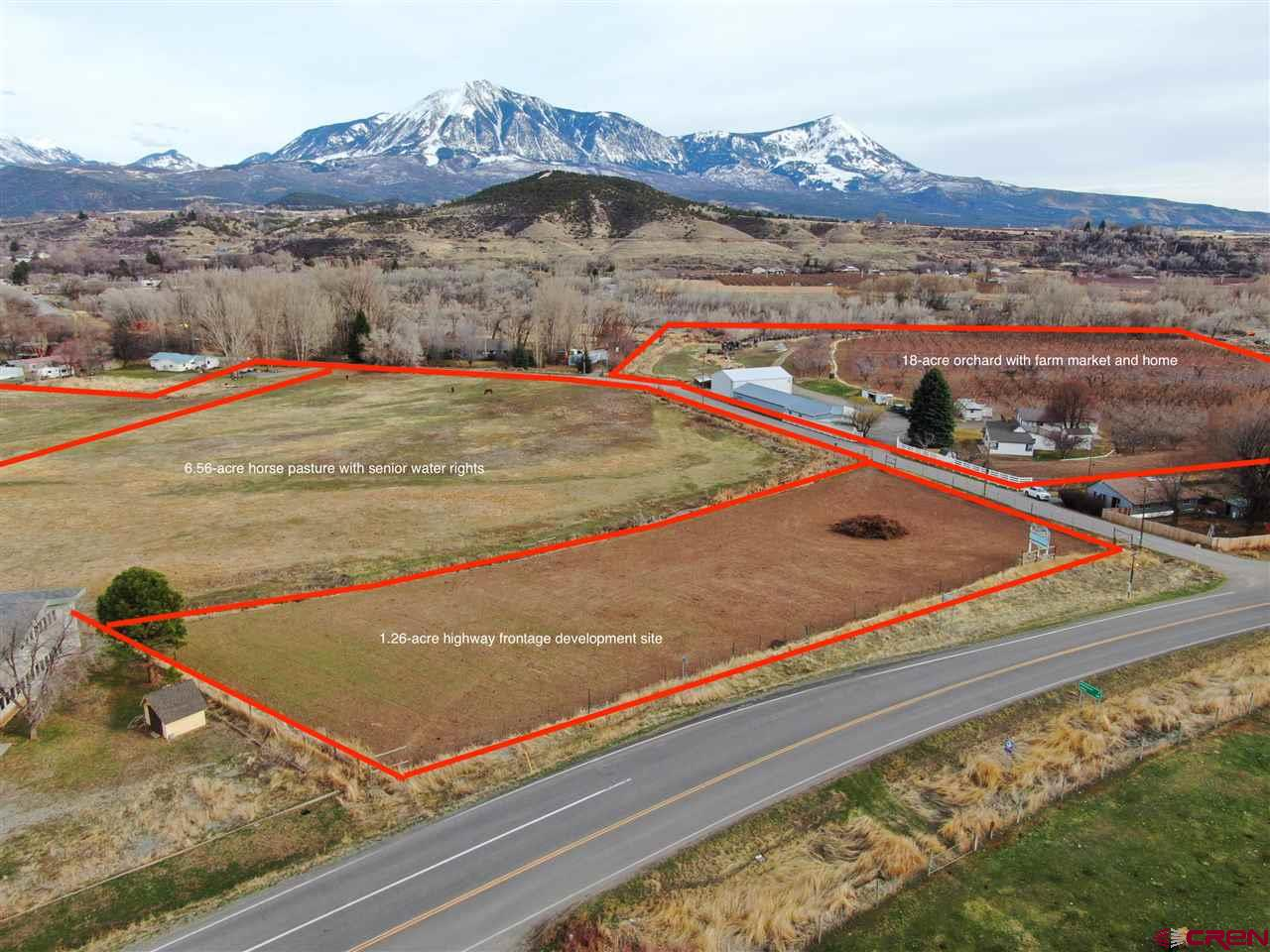 This is a prime 1.2-acre development parcel for commercial use at the entry to the Town of Paonia. Located outside of the town boundaries, this parcel has over 300 feet of frontage on Highway 133 right across the street from the Stop N Save convenience store. It fronts Stahl Road on the south. For years, this parcel was used as a peach orchard, and has excellent water rights for crops. The peach trees were past their prime and recently cleared, so the parcel is ready for a new use, whether as an orchard, residential development, or commercial use. When looking at the aerial photos, this is the smaller parcel that is cleared, directly adjacent to the highway. Any development approvals would have to be granted by Delta County.