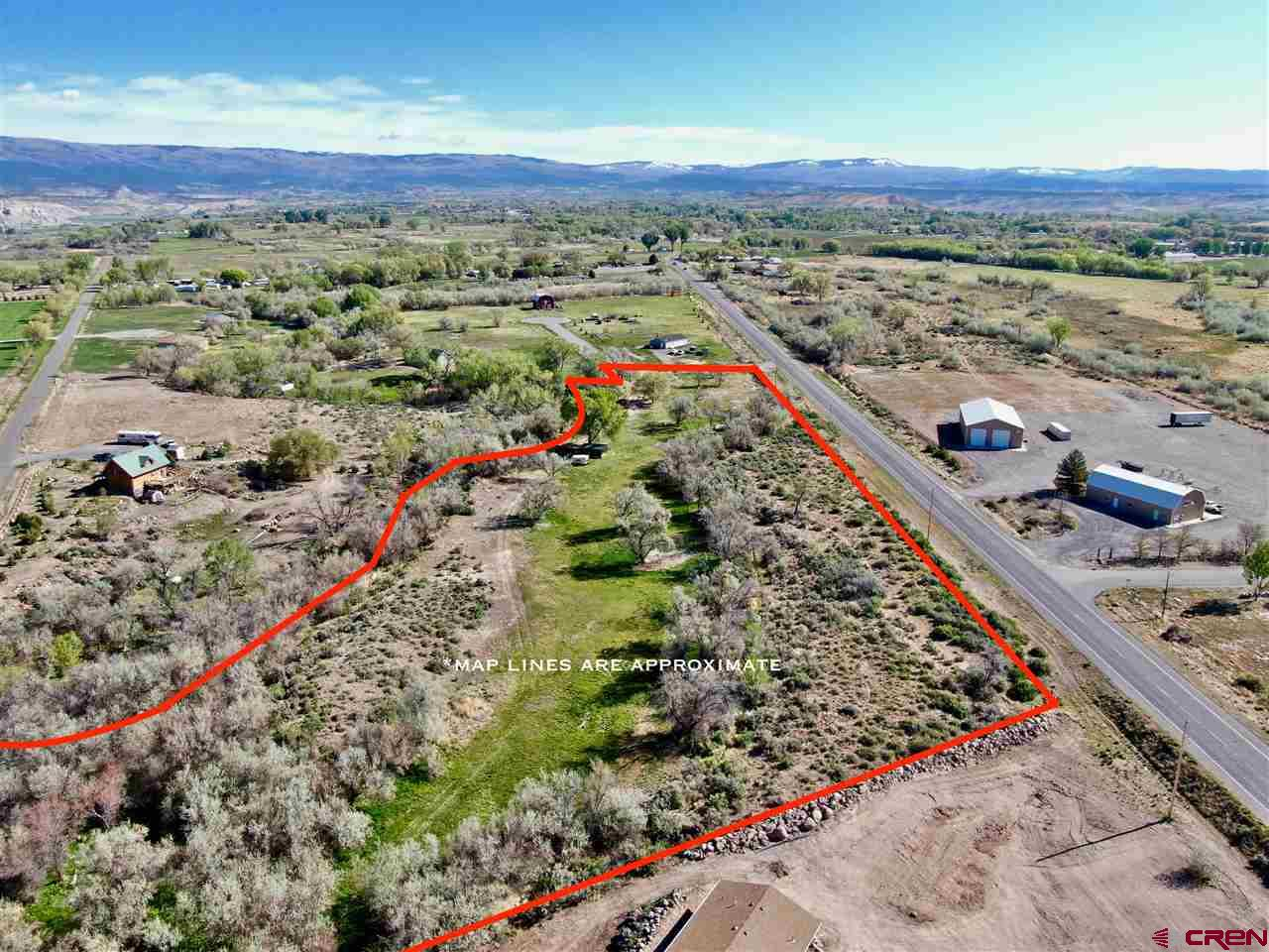 Residential / Commercial Development Land For Sale -- Ideal Building Site   This 8.39 approximate acres is located between the towns of Delta and Cedaredge, Colorado, on the southern slopes of the Grand Mesa. With Highway 65 running along the eastern border, and surface creek as the western border, easy access and a calm setting are just minutes from town. All utilities in place, high speed internet, phone, natural gas, electric. Irrigation and water rights with multiple CREEKSIDE building sites, with abounding views all around. Limited HOA/Covenants make this a great building site.   Zoned Residential OR Commercial, with restrictions on daily traffic amounts and noise levels. Great for small businesses looking for home & shop to conduct business. This 8.39-acre parcel may also be further subdivided in the future.   This 8.3 acres is water front to Surface Creek, and part of the Running Deer Estates subdivision, with new construction appearing. This vacant land for sale is mixed use, with the option to utilize a limited commercial use on the property as well as residential. One of the largest parcels of the subdivison, this property would be an ideal setup for horses or other agricultural animals, with approximately 4 irrigated acres, creek & highway frontage, and diverse terrain with multiple homesites. Property comes equipped with a Town of Orchard City water tap, and access to DMEA electric and Black Hills energy natural gas. Building your horse property or country home in a convenient location has never been easier.