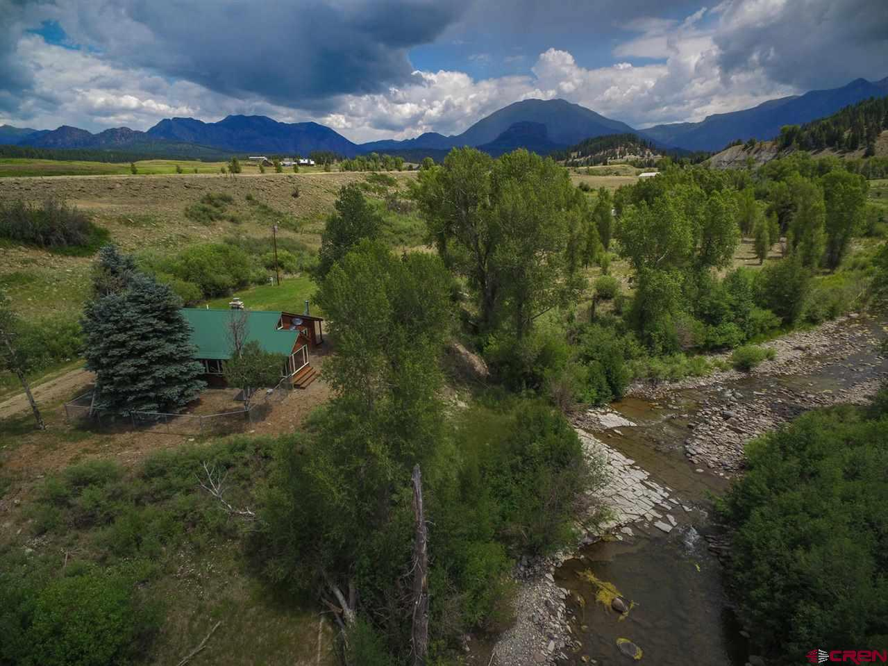 Don't miss this rare opportunity to purchase a 7 acre riverfront property in the Upper Piedra River Valley. This lovely retreat was remodeled in 2003. The home is perched a few steps away from the river where a private swimming/fishing hole awaits. This property has many unique and excellent features including water rights from the Baird Spring, an upper pasture with stunning, up close views on the San Juan Mountains, and privacy. Please call today to set up your private viewing of this fantastic property.