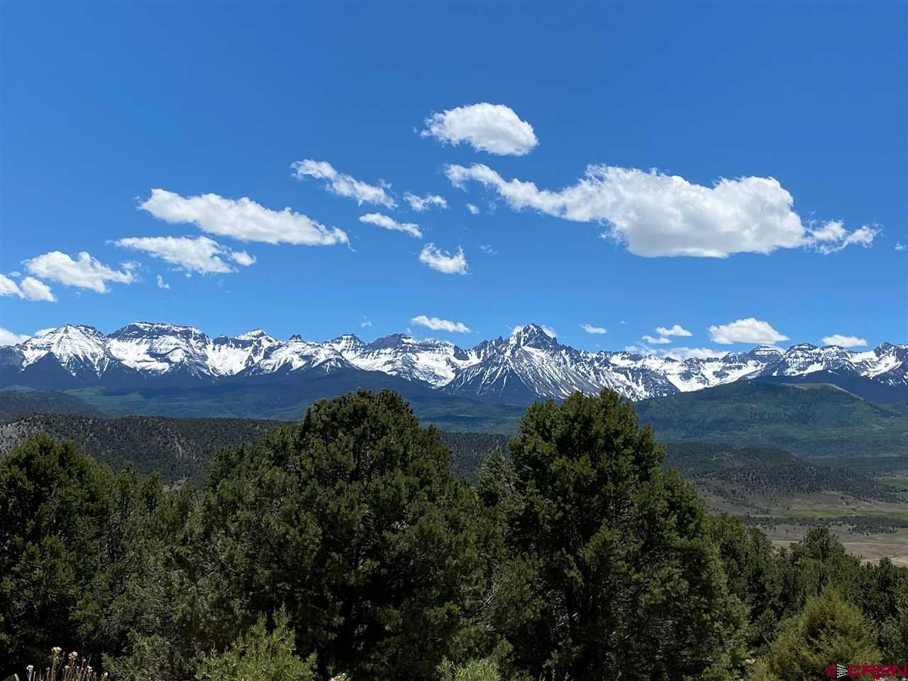 Were you looking for mountain views?  Well look no more.  The purchase price includes HUGE San Juan Mountain views and equally as HUGE valley views.  This parcel is located at the end of a cul-de-sac, and  is adjacent to a private 8 acre parcel to the east and an 8 acre open space to the west which makes the privacy factor immense.  The trees are a mix of tall Ponderosa, Juniper and Pinon.  Tri-County water, Black Hills Natural gas and San Miguel power are on the property line.  An engineered septic would be required.  Pleasant Valley has always been a sought after location in the county since it is perched above the valley and has direct views of the mountains.  Short drive to the Town of Ridgway and approximately 45 minutes to the Telluride Ski area.  Don't miss this one!