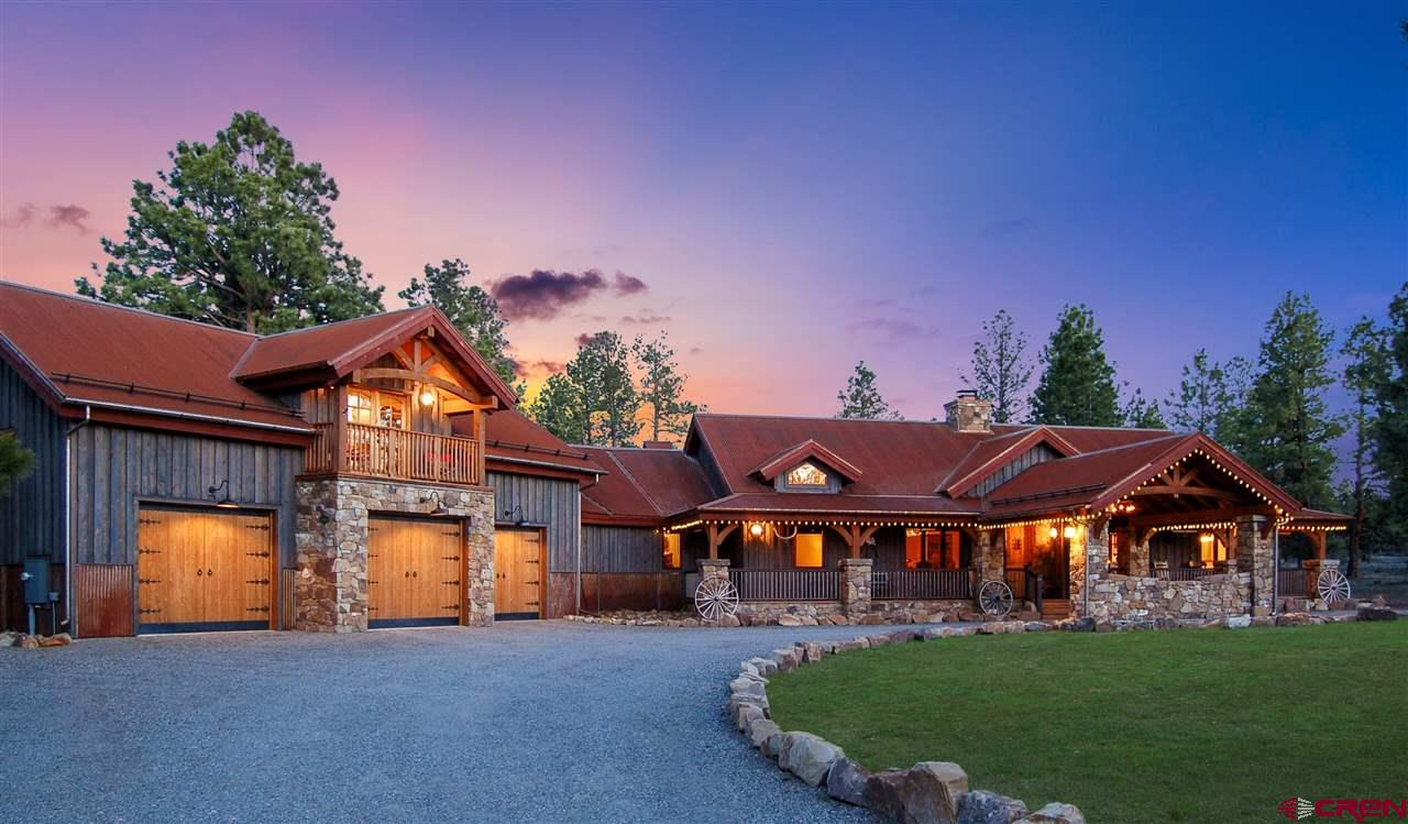 Nestled amongst the tall ponderosa pine trees in Southwest Colorado is this magnificent custom-built mountain lodge home with the feel of the old west. Find your personal getaway in this beautiful rural setting. This is a perfect retreat for the recreational enthusiast with all the luxury amenities and amazing open meadows and open space. The entry of the home greets you with an impressive handcrafted stone fireplace. The stones of which all came from the property after the excavating was completed. This gourmet kitchen includes beautiful knotty alder wood cabinets, leathered granite counter tops, and includes a 160-bottle wine fridge, perfectly fit for entertaining. The magnificent outdoor living area comes complete with yet another stone fireplace, BBQ, bar, large screen TV area. The perfect place for those Sunday afternoon gatherings or just a simple, quiet evening with the fire ablaze. The back of the house has a huge wrap around deck that totals over 1000 s.f. Upstairs above the garage is the 1057 s.f. bonus room complete with a 10 ft screen and comfortable theater room. The oversized 3-car finished garage comes fully equipped with an attached shop and plenty of storage. This 3551 square foot home sits on 3.5 acres of land and has an optional lot for sale next door with 3.5 acres. With plenty of feed and timbered tree lines, deer and turkey have all the habitat they need to flourish on the surrounding land.