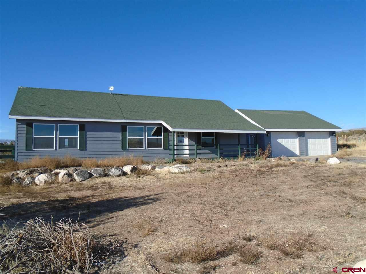 TAKE A LOOK  This 3 bed 2 bath home has gone through a complete facelift.  The interior has been painted.  New flooring installed, new windows installed, new faucets, new front door.  The deck on the west end of the home has been rebuilt.  This home is ready for a new owner.  The home is a split floor plan.  The 2 car garage is detached but very close to the home.  The 11 acres is nearly all native sage brush and oaks.  There is a seasonal ditch that flows through the west side of the property.  Drive has had several loads of gravel spread out this spring.  Take a Look, this could be your new home.