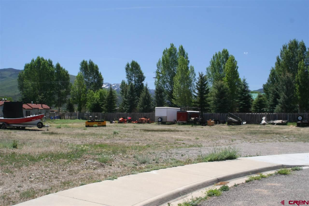 Business/commercial lot in the new industrial park...large .74 acre lot. Private end of the cul-de-sac location and just east of newer mini storage. Nice mountain views and walking distance to downtown and the park!  Zoned Light Industrial 1