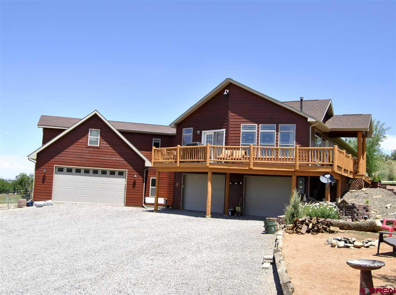 Need Space? NO Covenants? Check out this 5 bedroom, 3 full bath home on 6.894 irrigated acres. There is a 4 car attached garage and a separate 1280 sq.ft. Shop. Now to talk about the inside features. This home has had some remodel in 2018 which included finishing the interior of the garages and completing the bonus room over the garage which increased the home by 352 sq.ft. This house also boast of a Cook's Kitchen with a large island and prep sink, Corian counter-tops, stainless appliances and gorgeous slate floors. The master suite comes equipped to completely relax by its own fireplace after taking a long bath in the jetted tub which is included in the on-suite along with a double sink vanity. As you can see there are too many amazing features to list so come take a look at this incredible home.