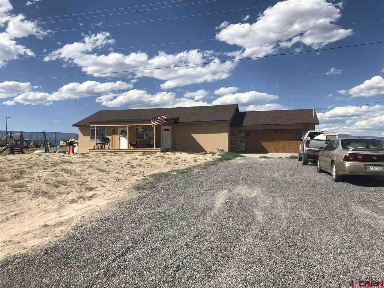 New home that was built in 2019! 3 bedroom, 2 full bath home that is still like new and clean and ready to move into. Good sized bedrooms. Natural Gas forced air and central A/C. Gas and 220v are ran to the kitchen stove and water heater giving you the two options. Beautiful Panoramic views of the San Juans, West Elks, Grand Mesa, and the entire Valley below. Great Central Delta County location! Plenty of parking, no covenants or HOA. Currently not landscaped which allows for your own personal touch and design.