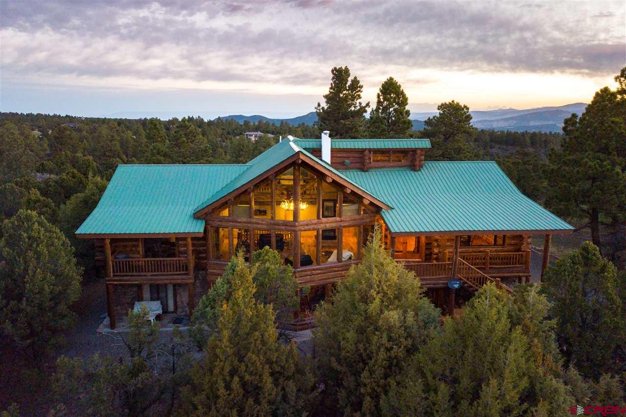 Dallas Ranch  Located in the outskirts of the picturesque mountain town of Ridgway, this custom log home situated on the 12th Fairway of the Divide Ranch and Golf Club is masterfully designed with elegant wood and stone interior and exterior accents. Its a mixture of both beauty in a mountain setting and a unique golf experience with the picturesque views of the San Juan Mountain Range. Wildlife abounds with giant mule deer and elk bugling right in your front yard.   Improvements This beautifully constructed home offers a large and open floor plan, vaulted ceilings, abundant windows with incredible mountain grandeur, and tons of natural light. The newly remodeled log home boasts, granite counters, spacious master bedroom with a warm gas fireplace, a stunning master bathroom, an extra-large walk-in closet. Along with gorgeous wood floors, It exudes luxury with the awe-inspiring great room,  impressive stone fireplace, and intricate detail in the woodwork. The lower level provides an entertainment room, custom-built bar, and gas fireplace, perfect for your guests. This gorgeous log home tucked back in the large ponderosa trees is peacefully situated for enjoying the stunning views and breathtaking sunsets, as well as a one-of-a-kind mountain setting.   Locale Just a short drive from Ridgway, Ouray, Montrose, Black Canyon, and some of the best skiing our country has to offer Telluride. This property is so close to a vast array of year-round outdoor activities from hunting the many public lands in Colorado to fishing the Uncompahgre and other wold renowned streams on the western slope.  Call us today for a qualified showing of this fantastic property.