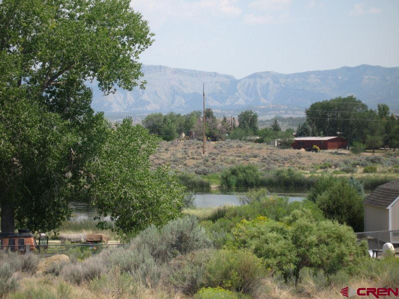 This is a combination of Lots 7 & 8 in Lakeside Commons to equal just under .9 acres!! That is a lot of space located in town right next to gorgeous Denny Lake. Two water meter pits are installed (no paid taps) and a sewer tap is available. Depending on where you build you can have views of Denny Lake, La Plata mountains and the Mesa!! This neighborhood is well established with great homes and foliage. Developers this is a good site to build a duplex by putting a unit on each lot!! Sign is on property.