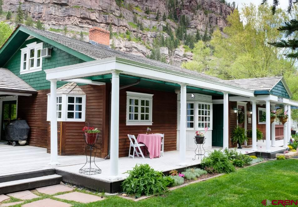 """Have you ever thought about owning an established Bed and Breakfast tucked away in a quaint mountain town in Southern Colorado? Well wait NO Longer.  This Great opportunity awaits you in the town of Ouray, Colorado. Nestled in the heart of the San Juan Mountains.   This well established and turn-key operation is now being offered and waiting for you to move in!  The lower level provides owner's quarters with private access including 2 bedrooms, office/living or one large suite.  While it is currently owner/occupied, it is perfect for investors looking to have an absentee ownership. This old style architecture is in great condition and provides the warmth and feeling of """"being home"""". Renovation of this property was completed in 2020 offering many upgrades including new flooring, new bathrooms all new paint inside and out. New furnishings including: linens, mattresses, and furniture throughout.   With 5 guest rooms and 5 bathrooms, the entire home will accommodate up to 12 guests. A Guest kitchen is provided where a Hot Breakfast is served fresh each morning. There is also an all day guest coffee bar with fresh treats.  Next to the Living quarters there is a large commercial kitchen currently rented to a caterer as a long term rental.  Additionally on the lower level you will find parking garages for 4 vehicles.  One is currently being used as the Laundry/storage area with two new commercial grade washer/dryers.  The beautiful flowered and treed private courtyard area makes for the perfect venue for weddings, family reunions, or private events where it can easily accommodate up to 200 guests. The facility has everything you will need for the perfect venue. You can soak in the hot tub, relax on the covered porch area or in the large family room with your favorite book.  You are a short walk from the main street of downtown Ouray where you can enjoy all the art galleries, local restaurants, coffee Houses, and entertainment. In addition, a short distance to some great hi"""