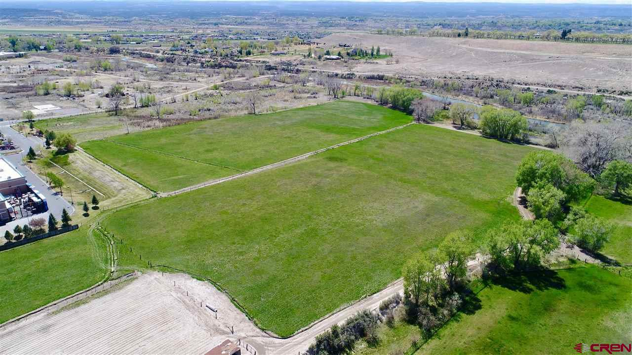 Here it is, one of the last commercial development opportunities in the hub of Montrose! This listing is for Lot 4-B which is 1.93 acres. There are (8) parcels for sale, all listed separately. These prime B-2 zoned parcels are off of the future 100 ft Rio Grande Avenue and the Ogden Road extension, which will play a key factor in giving frontage to these parcels. Take in the Uncompahgre River to the west, the beautiful San Juan Mountain Range to the south, and the new bike paths which will provide both road and foot traffic. Flat, usable parcel with gravel on site which can be crushed and used for roads. This is potentially a huge cost savings. Located near the signaled intersection of South Townsend and Ogden road, this property has excellent exposure and is easy to access. This is a prime location close to City Market South, Walmart Superstore, next to Home Depot, Target, Marshall's, Natural Grocers, Golden Gate Gas Station and the new Montrose Rec Center. One of the last prime development properties close to the river in the City of Montrose.