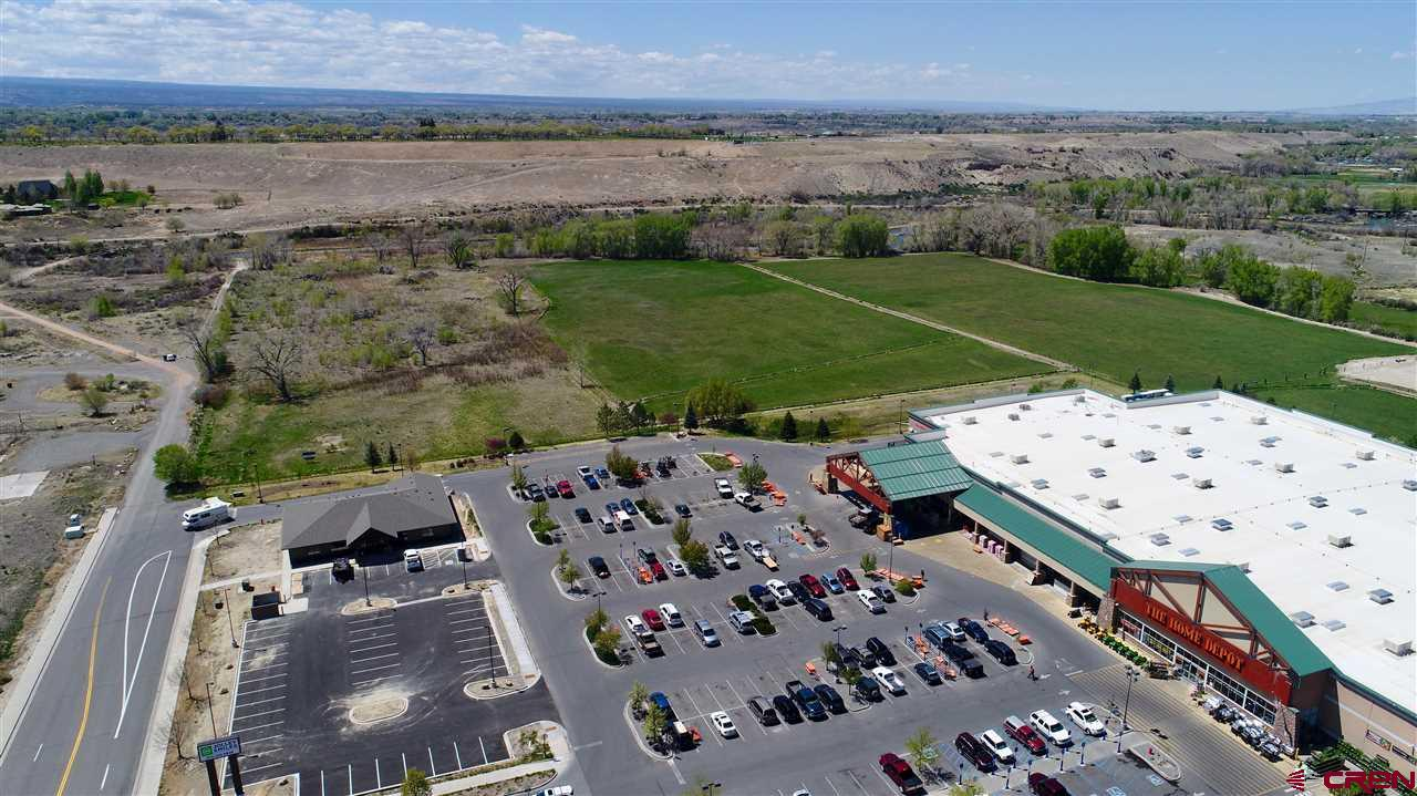 Here it is, one of the last commercial development opportunities in the hub of Montrose! This listing is for Lot 4-E which is 2.39 acres. There are (8) parcels for sale, all listed separately. These prime B-2 zoned parcels are off of the future 100 ft Rio Grande Avenue and the Ogden Road extension, which will play a key factor in giving frontage to these parcels. Take in the Uncompahgre River to the west, the beautiful San Juan Mountain Range to the south, and the new bike paths which will provide both road and foot traffic. Flat, usable parcel with gravel on site which can be crushed and used for roads. This is potentially a huge cost savings. Located near the signaled intersection of South Townsend and Ogden road, this property has excellent exposure and is easy to access. This is a prime location close to City Market South, Walmart Superstore, next to Home Depot, Target, Marshall's, Natural Grocers, Golden Gate Gas Station and the new Montrose Rec Center. One of the last prime development properties close to the river in the City of Montrose.