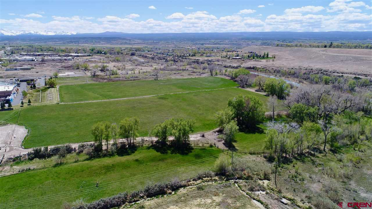 Here it is, one of the last commercial development opportunities in the hub of Montrose! This listing is for Lot 4-F which is 1.48 acres. There are (8) parcels for sale, all listed separately. These prime B-2 zoned parcels are off of the future 100 ft Rio Grande Avenue and the Ogden Road extension, which will play a key factor in giving frontage to these parcels. Take in the Uncompahgre River to the west, the beautiful San Juan Mountain Range to the south, and the new bike paths which will provide both road and foot traffic. Flat, usable parcel with gravel on site which can be crushed and used for roads. This is potentially a huge cost savings. Located near the signaled intersection of South Townsend and Ogden road, this property has excellent exposure and is easy to access. This is a prime location close to City Market South, Walmart Superstore, next to Home Depot, Target, Marshall's, Natural Grocers, Golden Gate Gas Station and the new Montrose Rec Center. One of the last prime development properties close to the river in the City of Montrose.