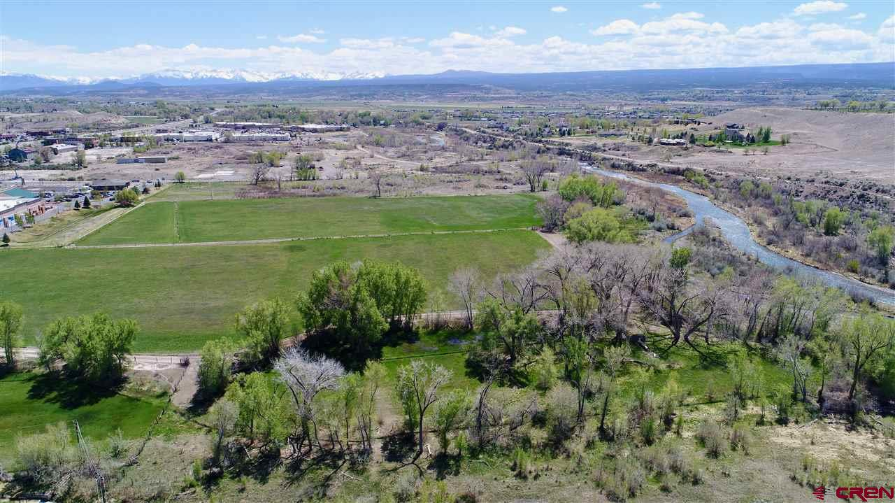 Here it is, one of the last commercial development opportunities in the hub of Montrose! This listing is for Lot 2-A which is 4.01 acres. There are (8) parcels for sale, all listed separately. These prime B-2 zoned parcels are off of the future 100 ft Rio Grande Avenue and the Ogden Road extension, which will play a key factor in giving frontage to these parcels. Take in the Uncompahgre River to the west, the beautiful San Juan Mountain Range to the south, and the new bike paths which will provide both road and foot traffic. Located near the signaled intersection of South Townsend and Ogden road, this property has excellent exposure and is easy to access. This is a prime location close to City Market South, Walmart Superstore, Home Depot, Target, Marshall's, Natural Grocers, Golden Gate Gas Station and the new Montrose Rec Center. An ideal location for a Hotel, Lowe's, or other Big Box stores. One of the last prime development properties close to the river in the City of Montrose.