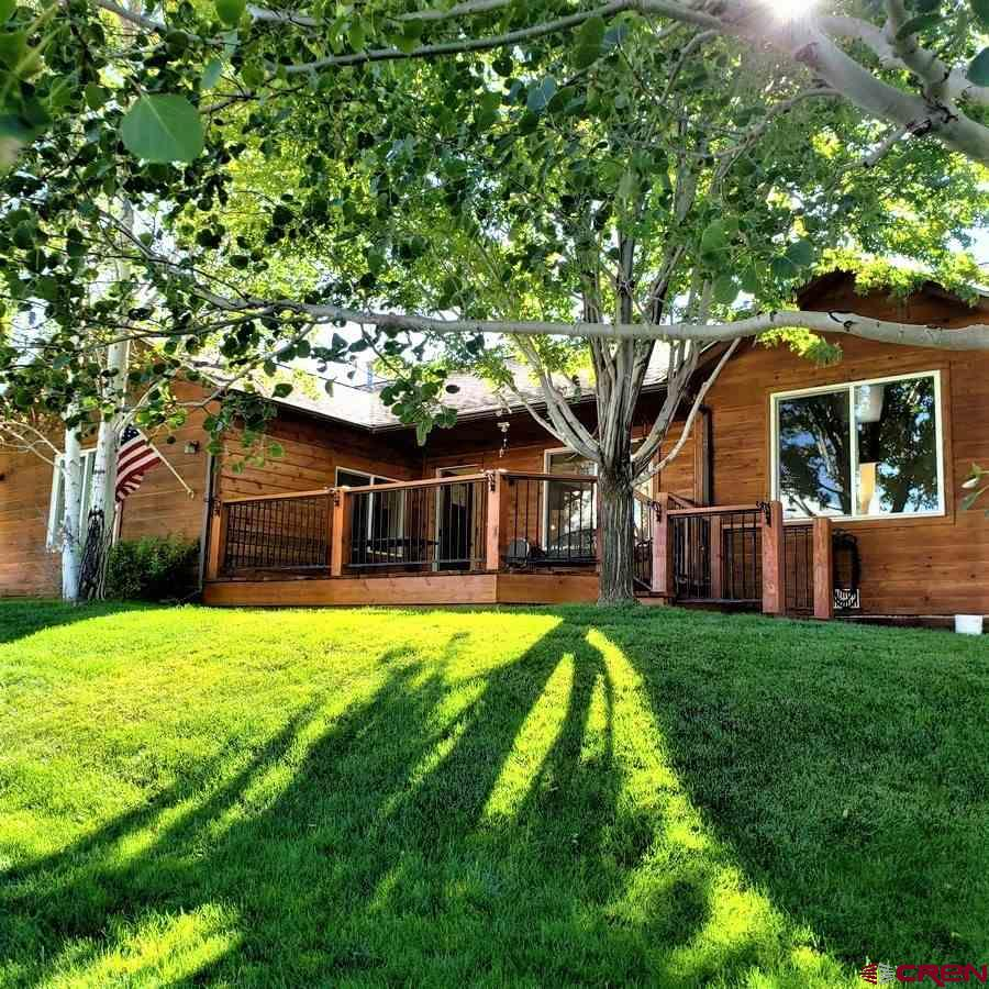 """In town Ridgway.  Marie Scott subdivision. Walk to school & town events.  Newly remodeled (2019-2020). 1872 SF 3 B-2 B w/detached over sized 2 car garage (1050 SF) with large side workshop (handyman's dream). Large garage overhead storage. Open concept-kitchen-living room-dining. Hard wood floors. Oak cabinets. Stove in living room. Large family room with stove.  Cedar siding (re-stained in 2019). Large front wooden deck (re-stained 2020). Views to the Cimarrons from the front deck. Fully fenced front yard- mature lawn with sprinkler system. Mature trees & landscaping (grove of Aspens /Maple /Cottonwood). RV parking S side-gravel. Outside fenced storage (""""toys""""-boat) with full length concrete pad on north side.  2020 Remodel: Newly painted throughout /New appliances (refrigerator-dish washer-gas stove) / new hard wood flooring in living room-kitchen/ new base boards /new windows throughout + new sliding glass door/New interior doors  (Alder) & new front door/new bathroom tile & fixtures /new evaporative cooler /new instant gas water heater/ new composite roof (2019)."""