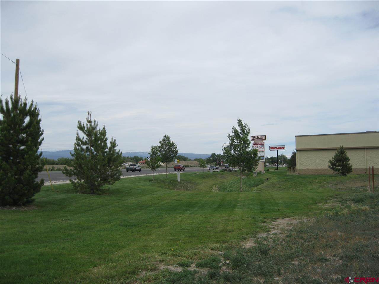 High Visibility Commercial Lot Vacant lot located in the heart of Delta's commercial hub with approximately 191 feet of highway frontage and 14,000+ daily vehicles. Situated in the Delta Center, in front of the Valley View Plaza adjacent to Auto Zone. The Delta Center is one of only two similar shopping centers within a 20-mile area. Just off Highway 92 near Walmart and Safeway, it is centrally located for shoppers from Delta and the surrounding communities. All utilities are to the lot line. Lot 1 has available drive-thru potential for quick service restaurant and highway signage.  Possible owner carry, build to suit, land lease or joint venture with qualified buyer.