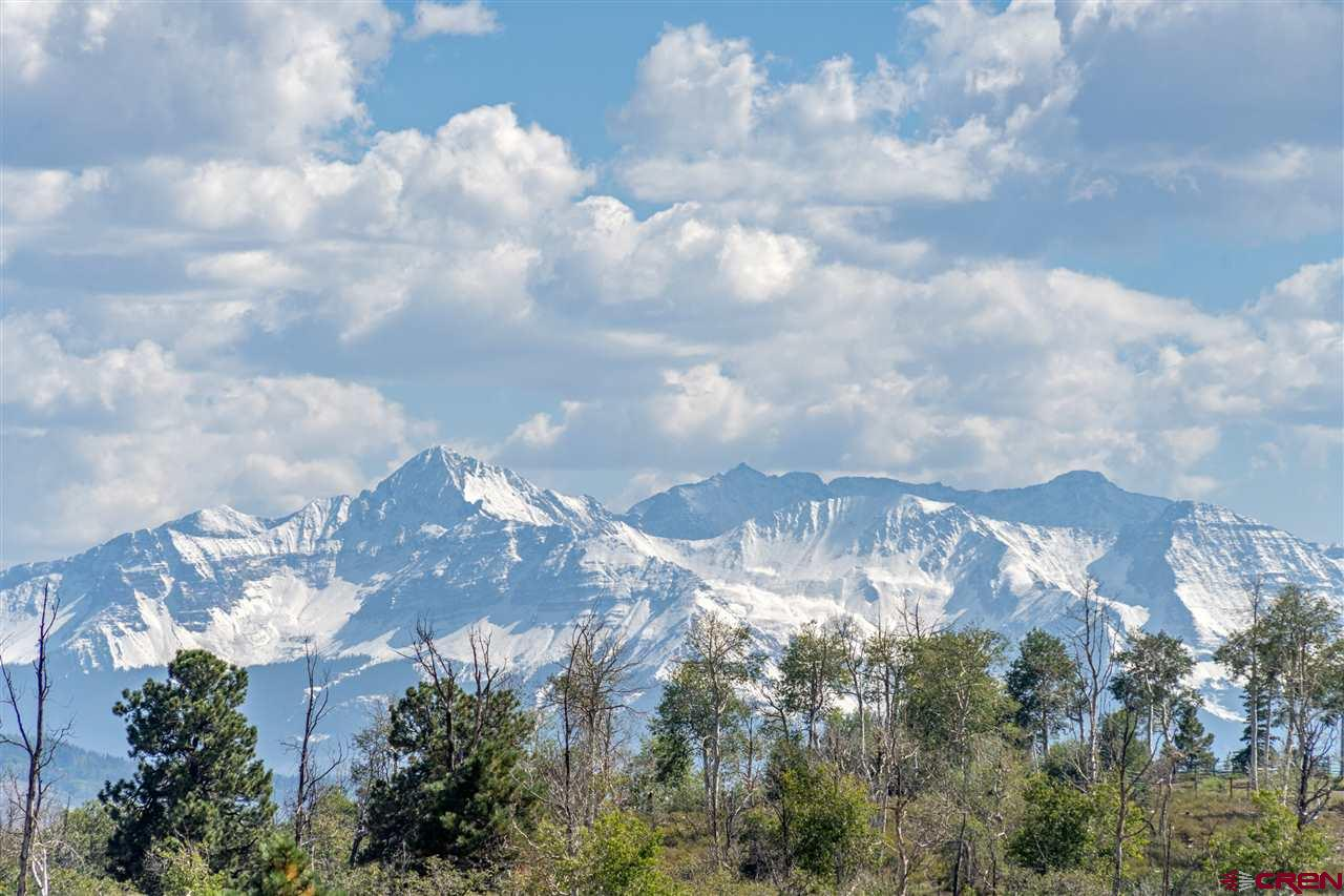 This is a fabulous getaway opportunity, just a half hour from Telluride and Ridgway. With a paved road to the top of the mesa access is easy and the 35-acre property is set on an escarpment with sweeping views to the Cimarrons, the Wilsons and back to Telluride. A must-see for land-shoppers in our area!