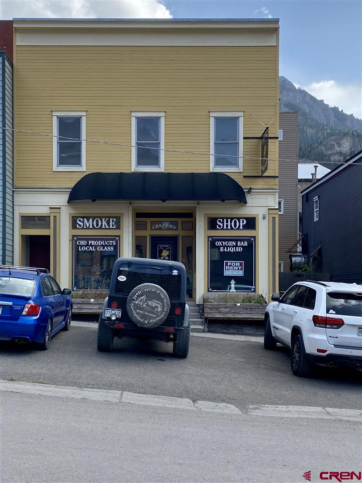 Great investment property 1/2 a block off of Main Street, on one of the very few paved streets in Ouray. The retail space has great curb appeal with large windows fronting 7th Avenue. The upstairs apartment has a separate entrance accessed from 7th Avenue, it features big widows, nice views, a cozy fireplace, a west facing balcony and sits right in the heart of Ouray. This two bedroom, one bath apartment has a long term month to month tenant, it could also be used as a Short Term Rental. It has so much potential and priced to sell!