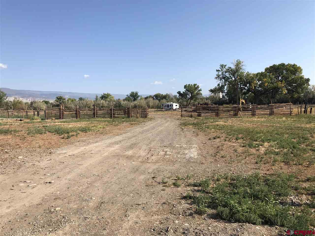 Desirable river frontage awaits!  No covenants, not in City limits either!  Power and water have both been brought onto the property - there are several frost-free water spigots for watering livestock!  Minutes away from downtown shopping with lovely views of Grand Mesa and more!