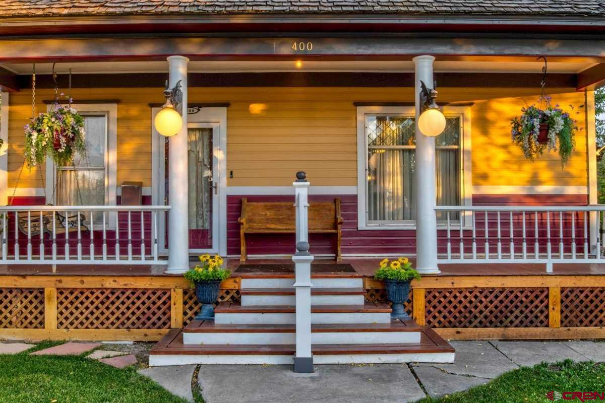 Beautifully updated Turn of the Century home centrally located in Montrose. With over 2000 sq.ft. of living space includes 3 Bedroom and 2 full bathrooms, hardwood flooring, lead glass windows, a chef's dream kitchen with a Mahogany wood countertop island, an antique wood stove, claw foot soaking tub, just to name a few. Upstairs the second bedroom/office space and Master bedroom boast, walk-in closet, with plenty of storage.The bedroom on the main floor features a hand painted floor, extra storage space, the ensuite bathroom features a walk-in corner shower, and tile flooring. Like to entertain, then this backyard is for you, outdoor kitchen, screen patio area, treehouse, water feature with raisde garden beds. The carport and original carriage house is an added parking and workshop area. Conveniently located near thelibrary and schools, shopping, dining,hospital, plus all that downtown Montrose has to offer! Schedule your tour today!