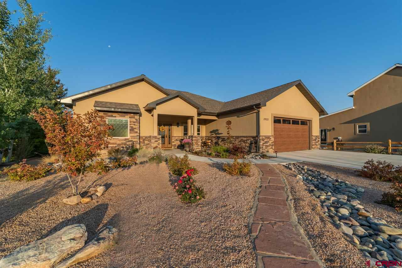 Beautiful, newer home with split floor plan on the course located at the end of a quiet cul-de-sac.  Home was built to provide an abundance of light and to enjoy the golf course, Uncompahgre Plateau and Grand Mesa views.  Open floor plan with both formal and casual dining areas, tray ceiling in the living room with ceiling fan and stone accented gas fireplace.  Knotty alder doors and trim throughout.  Durable Life Proof laminate wood flooring in living room, dining areas, and hallways with tiled kitchen, baths and laundry.  Spacious kitchen with plenty of rustic maple cabinets with pull outs, kitchen bar and built-in desk area.  Stainless appliances include a dual fuel gas range with double electric ovens, microwave hood, refrigerator and dishwasher. Tray ceiling and ceiling fan in master bedroom, too, as well as access to a quiet outdoor sitting area.  Carpet in the master bedroom with tile flooring in the master bath with separate bath tub and tiled shower, private toilet, and large walk-in closet.  Two guest bedrooms on the other side of the home, one with carpet, one with wood laminate flooring.  Large laundry room with extra cabinets and utility sink.  Finished two-car garage.  Forced air gas heat with central A/C, on-demand hot water heater.  Expanded back patio with two ceiling fans.  Small creek runs just beyond your lot line and catch and release bass and trout fishing is just steps away in a pond just passed the 18th tee box.  Beautifully landscaped with lawn and sprinkler system in backyard, easy maintenance xeriscaped front yard on drip system.  Home is not attached to a Cobble Creek social membership, eliminating extra monthly cost.