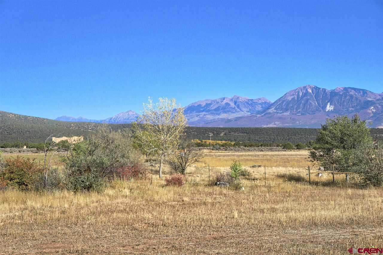 Irrigated acreage, no covenants, expansive views of the West Elk Mountains and North Fork Valley. Partially game fenced, gated pipe irrigation system, irrigation water storage pond. Very private feeling on the back part of the property. Irrigated land is in short supply, don't wait to buy.