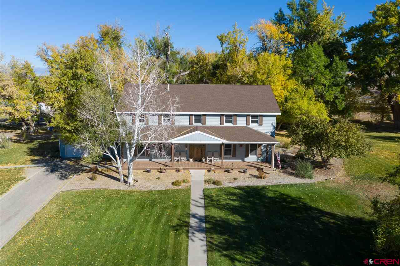 """Locals may remember this as the Black Canyon Arabians horse ranch and is what everyone seems to be looking for right now.   No covenants, 7 +/- acres, irrigation water, mountain and valley views, close to town, huge mature cottonwood trees, a pond, several thousand square feet of outbuildings, and a good sized home.   Home has so much to offer! 4-beds and 4-baths. Large kitchen big enough for several people to handle meal prep or cleanup without getting in each other's way and is central to the traffic flow throughout the home. Attached garage is one car but including the detached garage, the garage space is 20.  The view of the pond and trees will make you want to spend even more time in the kitchen/dining room. Plenty of areas to work and play, whether at the """"Pond"""", the """"Pasture """", the """"Trees/Shade"""", the """"Outbuilding area"""", the """"Garden/Riding arena"""", etc.   Additional outbuildings include a 6800 ft.² stable with four stalls, wash rack, feed room, tack room. 77 x 40 indoor arena, two foaling rooms with observation room and covered hay storage area. also included is an outdoor riding arena. The outbuildings are in fair condition but with a little TLC, this would again be an absolute showplace.  Second outbuilding is 65 x 24 covered equipment storage with a 744 square-foot shop.   Did you want views?? Enjoy mountain views to the south and west over the valley, particularly at sunset, along with a variety of wildlife!  This is a extremely unique property with trees to build a playhouse, a pond to float and enjoy watching the kids raise their 4-H animals, all from the front porch."""