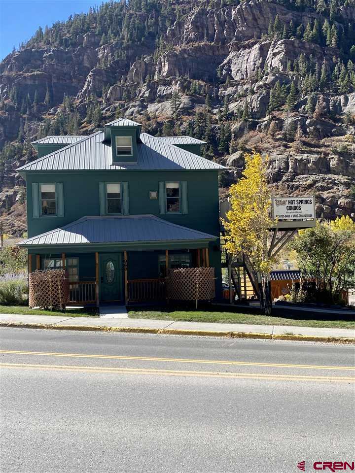"""This historic 3 story home at 960 Main Street, Ouray, Colorado, is nestled in the valley in between scenic rocky cliffs that border the very edge of town, with mountain peaks visible in all directions.  The home has been extensively remodeled and has been divided into 3 separate living spaces. Each has its own separate entrance, and collectively are referred to as condos. The ground floor lower """"Garden View""""condo sleeps 8 guests in 2 bedrooms and the extra sleeping area.  The upper floor """"Eagles Nest """" condo sleeps 4 guests. """"Buck's Hacienda"""" is the owner""""s deluxe one bedroom walk-out basement condo, it sleeps 2. Each condo is newly decorated with a Colorado  mountain theme.  This centrally located home is one block from the Ouray Hot Springs Pool and Spa, and it is only 5 blocks to the center of Ouray.        GROUND FLOOR GARDEN VIEW CONDO: The lower condo has  been recently remodeled with a Colorado wildlife camouflage theme. It has a large living room, a dining room, a complete kitchen, utility room with washer/dryer. There is a gas fireplace in the living room. The lower condo has two completely remodeled baths, and can sleep 8 people. There is a queen in the master bedroom, full size bunks in 2nd bedroom and a queen sleeper sofa in the living room. There is also the small 3rd sleeping area which has a full bed. There is a large ground level patio with a wrought iron table and chairs, and a gas grill.  It sells completely furnished, with all new window blinds and curtains.   """"EAGLE'S NEST"""" UPPER CONDO:  The upper condo has been recently remodeled with a Colorado wildlife theme.  The upper condo has a complete kitchen, a combined dining and living area, and sleeps 4 comfortably. The kitchen dining area will seat 7 guests. It has one large bath, washer/dryer, a queen in the master bedroom, and a nice 3rd floor loft for relaxing with a puzzle or to sit and read a good book. There is also a futon in the living room, along with a cozy gas fireplace. It sells complete"""