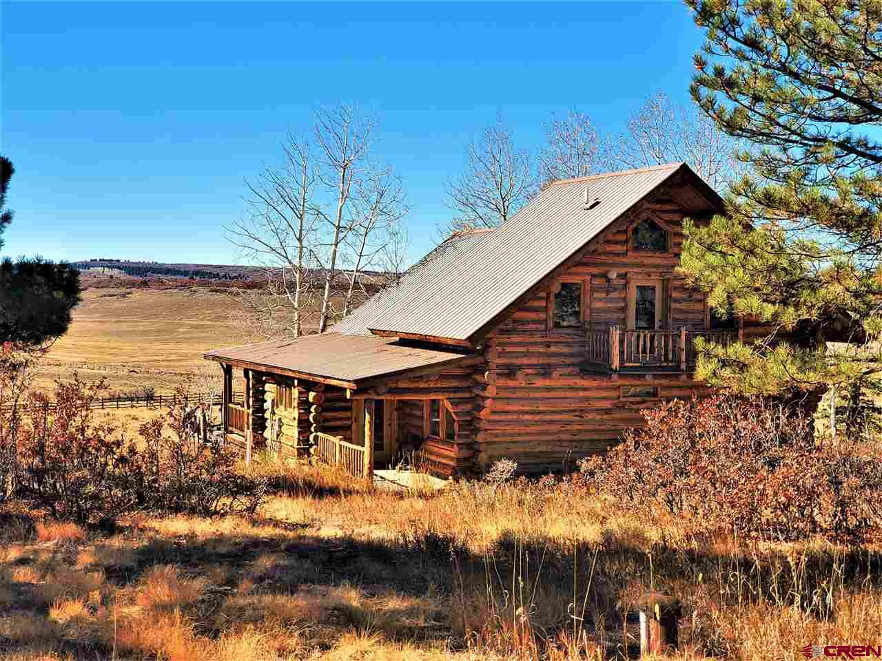 You couldn't ask for a better setting. This 3 bedroom 2 bath log home is just breath taking. Watch the wildlife and scenery from every direction. Year round access and serenity that goes on forever.