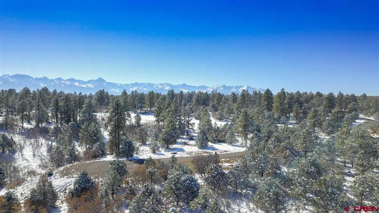 Large Lot in Divide Ranch and Club with 2+ acres gives you your choice of building sites. Water tap is paid and underground utilities are to lot line with paved roads in the subdivision. Offering spectacular views of the San Juan Mountains. This is in the core of the of the beautiful Divide Ranch & Club Golf course. Nicely treed with Ponderosa, Pinion and Juniper. Golf membership is included in price. Located in the award winning Divide Ranch & Club, 7,039-yard golf course. Factor in a high-mesa forest with phenomenal views of Cimmaron and San Juan Mountain ranges. Enjoy the golf club offerings luxurious community experience. Less than four miles from Ridgway, less than thirty minutes from Montrose and its regional airport, and a short drive from Telluride, and Ouray. Build your home here!