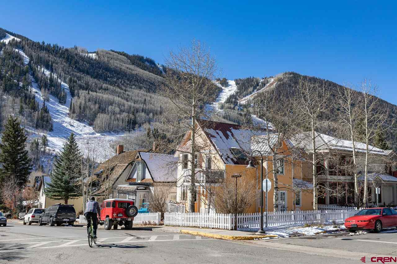 Located on a square, corner lot in the heart of Telluride's Historic Residential Neighborhood, this upscale 3-bed/3-bath gem boasts forever views and a downtown-adjacent location. The open-designed chef's kitchen captures big views of Ballard Peak and Telluride's Box Canyon from behind the sun-filled bay window. The master suite up one level enjoys the same views and more, featuring a private deck and en suite with steam shower and double-vanity sinks. Rated non-historic, the property affords many future options for its next owner. Included in the purchase price are Town-approved, vested remodel plans that would add 1,200 square feet to the current footprint. Ski to the gondola on powder days! Enjoy all that Downtown Telluride has to offer from this quiet, leafy remove.