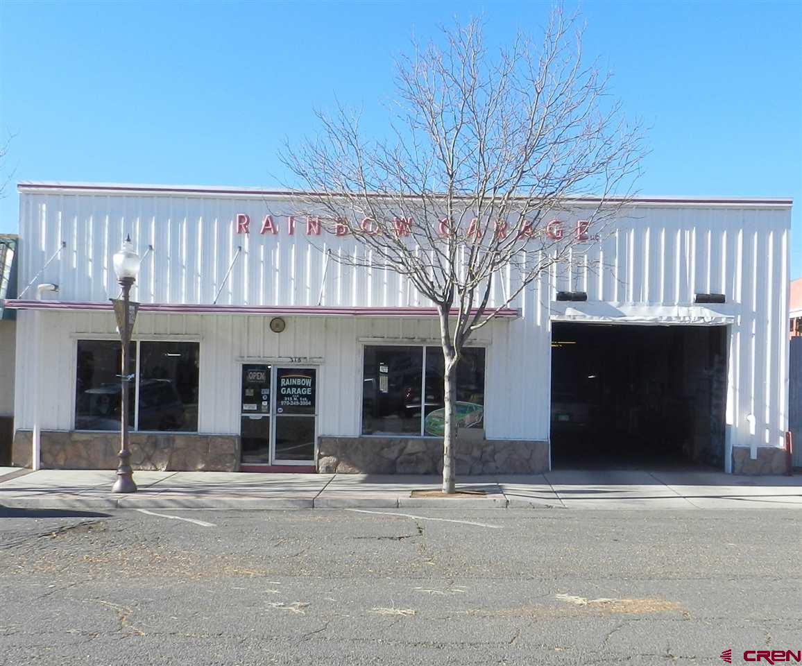 Thriving Mechanic Business Option or Real Estate Only Purchase the current business (Rainbow Garage) and/or the building and the vacant lot to explore the many options available in the B-1 zoning.  Rainbow Garage has been a successful business for 75+ years.  Building has open shop space, inviting lobby area featuring an office area with service counter/reception and restroom. Vacant lot for extra storage has a chain link fence and gated for added security. If you are looking to start your own mechanic shop, we have the perfect option for you!    Incredible tax break with Opportunity Zone designation!  This listing is for the building and the business - please inquire about the complete list of inclusions.  Possible owner carry with the right terms.