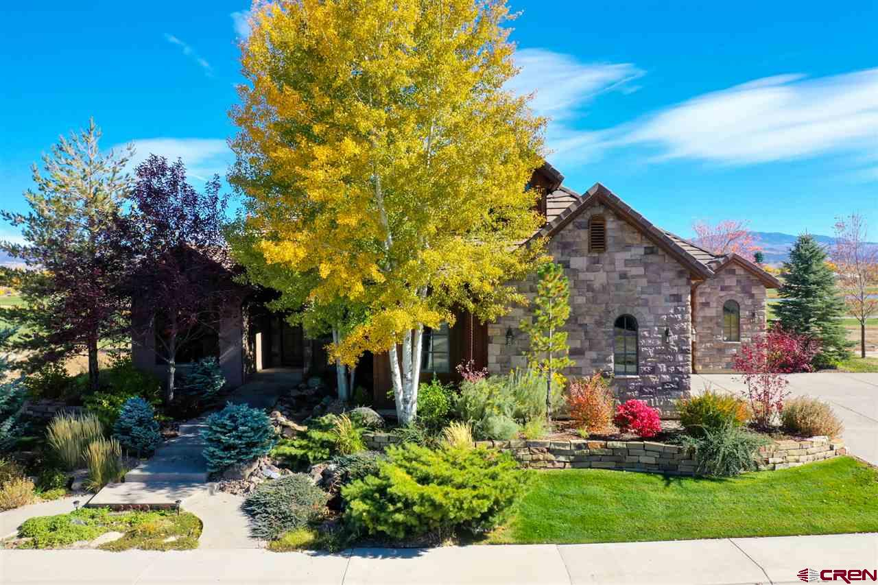 Mountain Elegance, Superb Alpine Views, and Country Club Amenities Accent This Perfect Colorado Getaway! The ideal location for a permanent residence or weekend respite. Fall in love with the ornate craftsmanship throughout this custom-designed home. Distinguished and exclusive, this property will amplify the mountain lifestyle you deserve. Highly detailed custom finish work adorns the home throughout, anticipating one's needs for accommodation and style. Host guests with finesse in the masterful chef's kitchen, complete with prep-island, bar seating area, and granite slab countertops. The outdoor living area is designed with epic proportions for fun with family and friends. Capturing fairway and mountain views to the south, the flagstone outdoor living area will be a focal gathering place for afternoon refreshments or morning coffee. When it's time to bring the fun inside, the home shines, flaunting an entertainment area, complete with a pool table and game nook. The living room provides warmth and comfort from the stone accent fireplace, custom wood beam inflections, and unobstructed mountain views to the south. Prepare to fall in love; this is the Colorado mountain property you deserve.