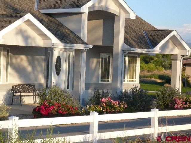 Elegant living, Hardwood floors, granite counter tops, soaking tube, bidet, sunny separate office for work at home with great views and separate entrance\.  Views, Views, Views,  Mountain views to the south.  Gourmet kitchen, eat in bar, breakfast nook. New carpet in two bedrooms and new paint.  Extremely comfortable living, great subdivision, irrigation water for a great garden and sprinkler system.  FREE, FREE, one year home warranty included.  No need to worry about repairs or breakdowns......   Seller is a licensed Real Estate agent in the State of Colorado.