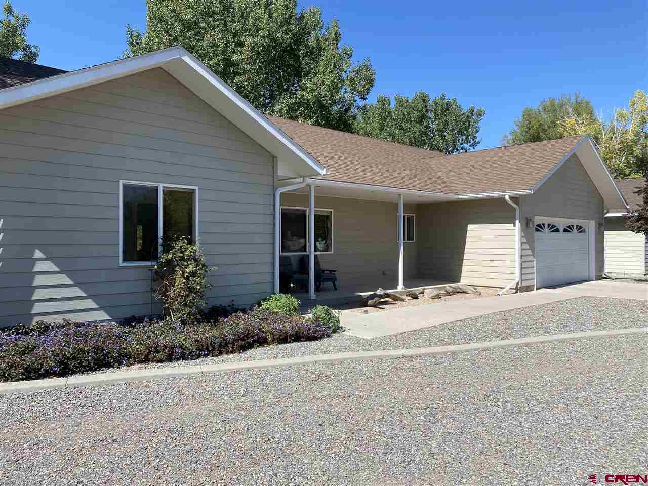 You must see this beautiful home before its gone! It is located in the exclusive neighborhood of Cactus Creek Subdivision on 1.4 acres with irrigation water. The last time a home sold in this neighborhood was in 2018! This home is very bright, clean, spacious and very well maintained. Floor plan features a split plan with the Master Suite on one side and two bedrooms on the other. The covered patio is perfect for afternoon BBQ's or morning coffee while staring at your San Juan and Cimarron mountain views. Enjoy the gorgeous, very large, dream backyard that has been immaculately maintained. There is plenty of room to park your toys and RV's. Schedule your showing before it's too late.