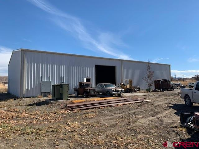 """Large 6,000 square foot warehouse with a 14' x 14' overhead door, built in 2010 plus a 960 square foot building, built in 1994 and was remodeled in 2016 and converted to a machine shop, plus a """"Tiny House"""", all situated on 1.08 acre.  Property has 3 phase electric 440, 220 and 110. Epoxy flooring over concrete is in the 6000 sq.ft. warehouse, which also includes in-floor heat, but it needs to be connected to the boiler, which is in place. The 6,000 square foot building was constructed in 2010.  Property also includes One Gunnison Valley Domestic Water Tap and Septic system is installed to the 320 square foot  """"tiny home"""" on the property, which includes a refrigerator and stove.  Great place for a machine shop, auto repair business or whatever you like.  Lots of parking area available.  Natural gas has been ran to the property line for easy hook-up."""