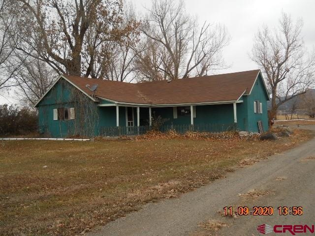 Two properties in a great location. Convenient to Delta or North Fork area. Great investment opportunity.  32865 is a 2BR/1BA stick built home built in 1909 with a detached one car garage/shop, 32823 is a 1977 3BR/2BA Single wide with a lease through 7/31/2021. This parcel has separate driveways and each dwelling has its own Rogers Mesa Domestic Water tap.
