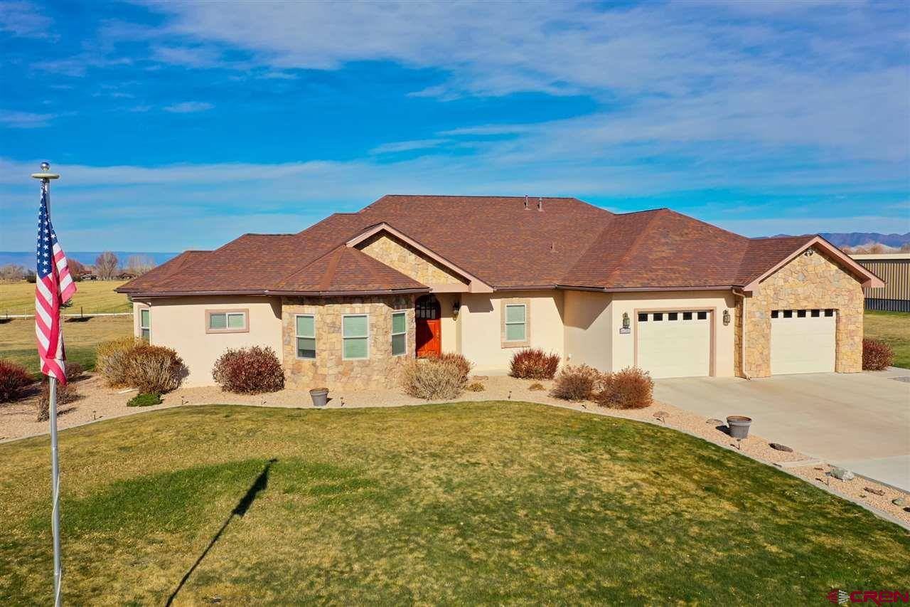 This 2941 square-foot, 3-bed 2.5 bath homes sits on 3 irrigated acres on beautiful Spring Creek Mesa. This home has it all for him and her, from the open kitchen space to the 4000 sq. ft. insulated heated shop. I asked the owners what they like about the home -- very open floor plan on one level from the kitchen to the living room, granite countertops, Brazilian hardwood floors, stainless steel JennAir appliances and the solid wood cabinets. From there they talked about the extra large master closet with access to the large central laundry room, the steam shower with jetted tub, and the library off the master with gas fireplace and the office. They also highlighted the oversized 2-car garage, foam block construction ensuring quiet living and super insulation, the ornamental iron fencing and the covered patio in the back yard. They also talked about the all-steel shop with a 1/2 bath, ample electricity for wood working, and 12 by 12 and 14 by 14 overhead doors. Both said the neighborhood is wonderful, with great neighbors.