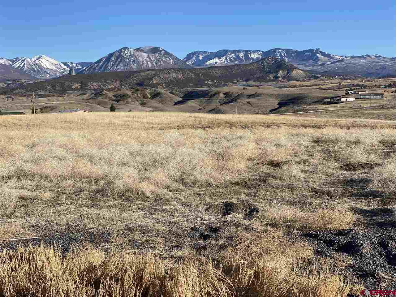 Blank Slate with wide open space and Million Dollar Views.  Stunning West Elk Range of the Colorado Rocky Mountains to the east and sweeping views of the Canyons to the south.  No deed restrictions and no covenants on this property allow for you to dream a little dream or big one.  County Road to the edge of the property, with nicely graved rock drive up to a private building site well off the road.  Desert like landscape with native vegetation is sparse but beautiful. A well can be drilled and Sellers agent shall provide Well Permit as needed.