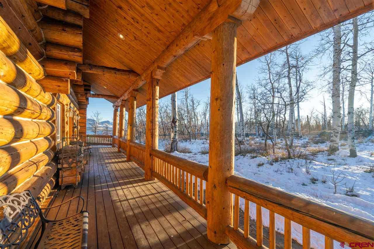 This classic log home is set on what is arguably the most dramatic bench on Iron Springs Mesa. Perched above open fields the property offers endless views encompassing everything from the Cimarrons to Sneffels to the iconic Wilson Range and has plenty of deck space. You can also watch the sun set over the LaSals from the west end of the ranch. The main level includes an open living/kitchen/dining area and dedicated office space. The three bedrooms are all above, including a spacious master with balcony and cozy fireplace, and a full flex room on the lower level is currently set up as a den/bunk room. A 2-car garage for car and toy storage rounds out the property and its location offers easy access to the National Forest. McKenzie Springs Ranch is between Telluride and Ridgway.