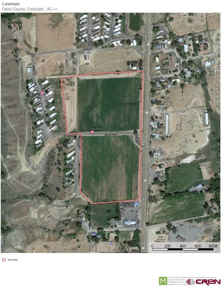 Irrigated farm ground with Hwy 65 access.  Possible development potential.  Borders Cherry Acres Mobile Park.  1300 feet of Highway frontage.