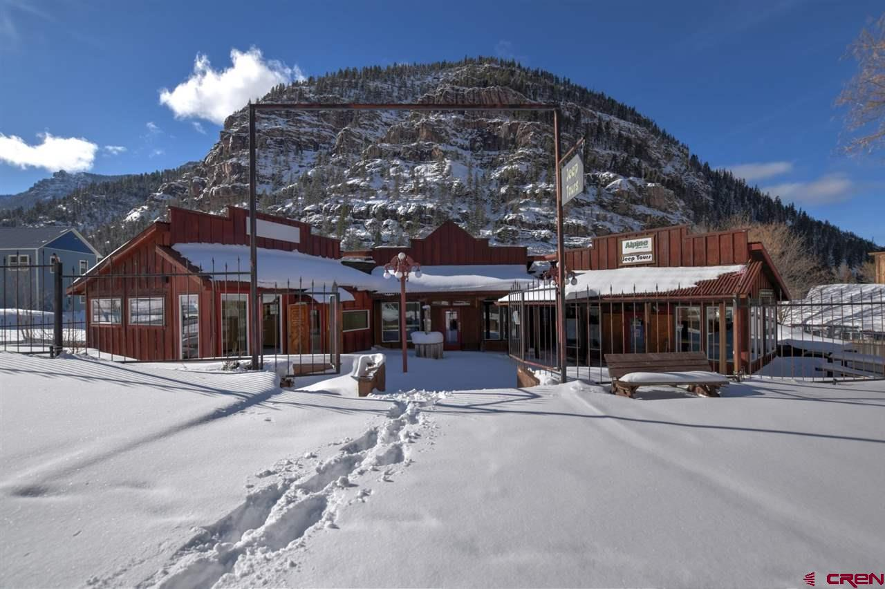 You can't beat this Main Street Location in Ouray, with high visibility. Located on the North side of Ouray just a short walk from the Ouray Hot Springs and  city park. The building offers three units with outdoor seating (office / retail space). Updated plumbing fixtures, electrical,  wall mount Rinnai water heater, windows and doors,  evaporative cooler, and heat system. Two updated restrooms. This is a turn key property with many potential income opportunities and businesses. Great opportunity to tap into Ouray with Colorado small towns booming.